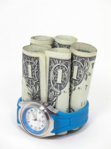 money surrounded by a watch