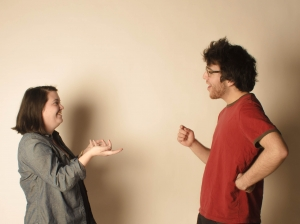Two_young_people_demonstrating_a_lively_conversation